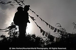GEX-EV-0169: Michael Brown walks amidst prayer flags in the Solu-Khumbu Region of Nepal.