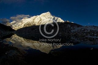 N-EVR-3127: Mount Nuptse and the shoulder of Mount Everest glow in the light of sunset and reflect in a pool in Gorak Shep at the foot of Kala Pattar, Solu-Khumbu Region, Nepal.