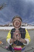 TD-EV-0156: An elderly Tibetan pilgrim prays outside the Potala Palace, Lhasa, Tibet.
