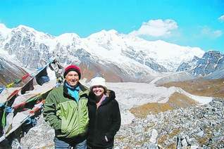 John Campbell and his daughter, Tamara, stand in front of Kanchenjunga, the third tallest peak in the world.