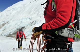 EB-EVEREST-8393: Ed Viesturs coils in Peter Whittaker below the Lhotse Face. © 2009 Eddie Bauer. Photo by Jake Norton.