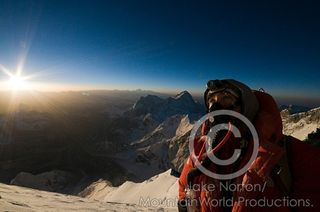 Climber John Griber gazes at the summit of Mount Everest at sunrise from 28,000 feet on the Southeast Ridge climbing route.