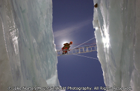 Sherpa crossing a crevasse on Mount Everest